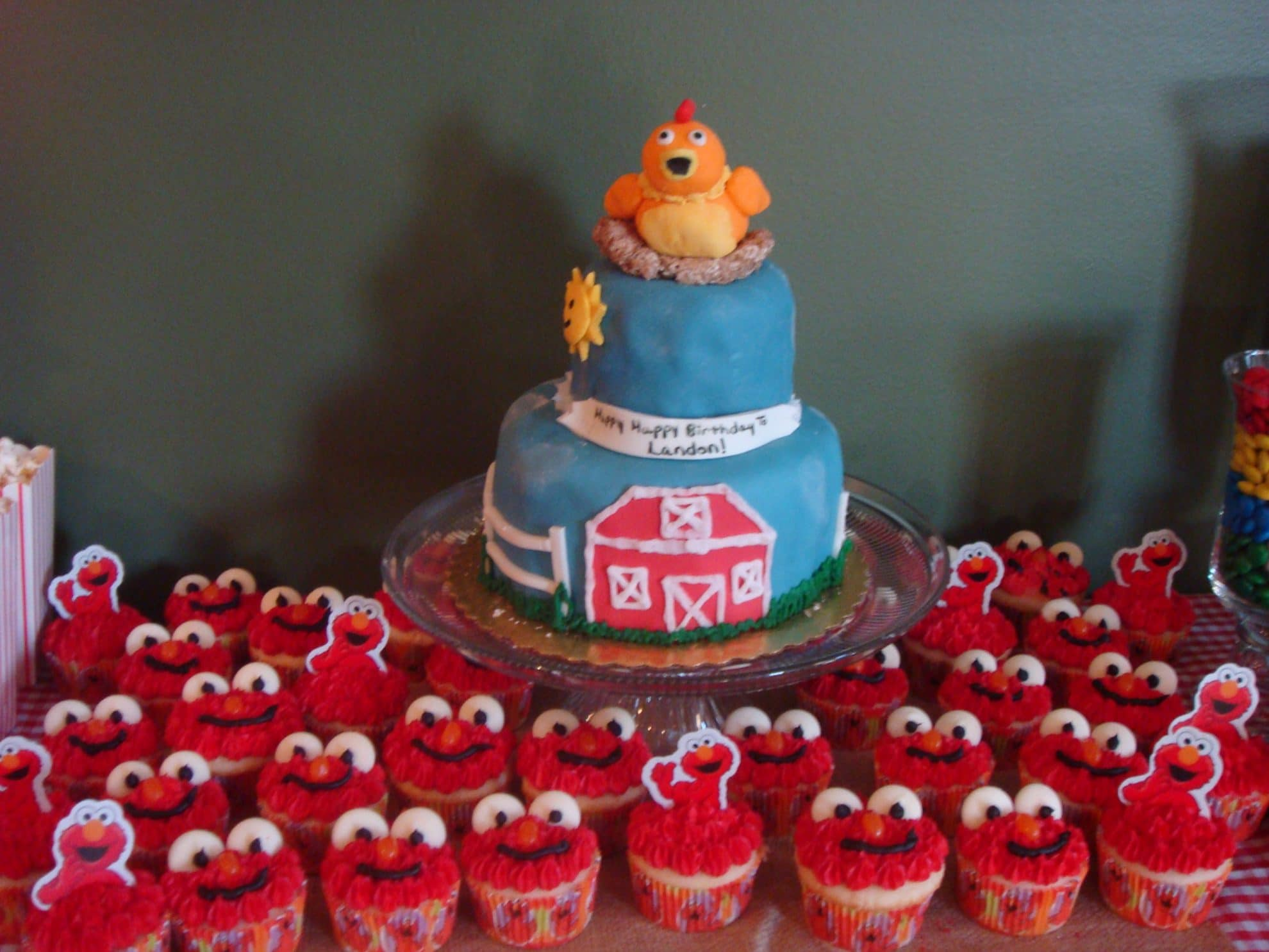 Sprouts Chica Cake and Elmo Cupcakes Landons 1 The Suburban