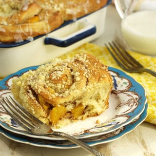 Peach Cobbler Cinnamon Rolls with Lemon Glaze