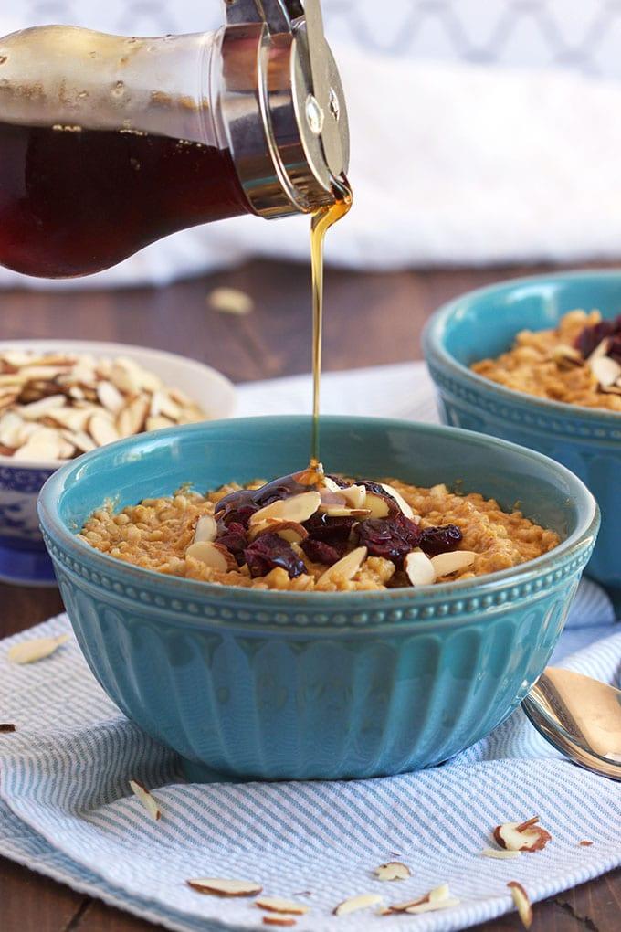 An easy weekday breakfast, Slow Cooker Pumpkin Spice Oatmeal is like warm pumpkin pie for breakfast! TheSuburbanSoapbox.com