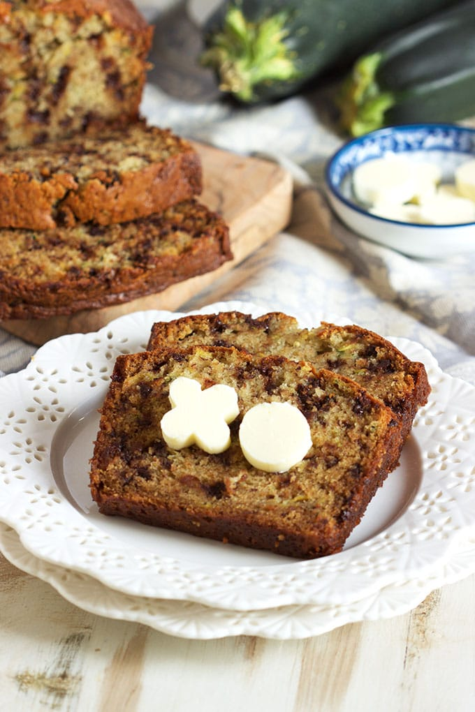 This super easy Zucchini Banana Bread recipe is studded with mini chocolate chips for a decadent sweet treat that's no short of addicting. TheSuburbanSoapbox.com