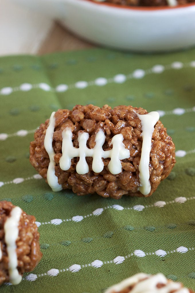 Super easy to make Rice Krispie Footballs, fun for any football or tailgating party. TheSuburbanSoapbox.com