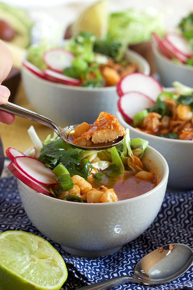 Super easy to make Pork Posole recipe is the BEST, most flavorful stew ever! TheSuburbanSoapbox.com