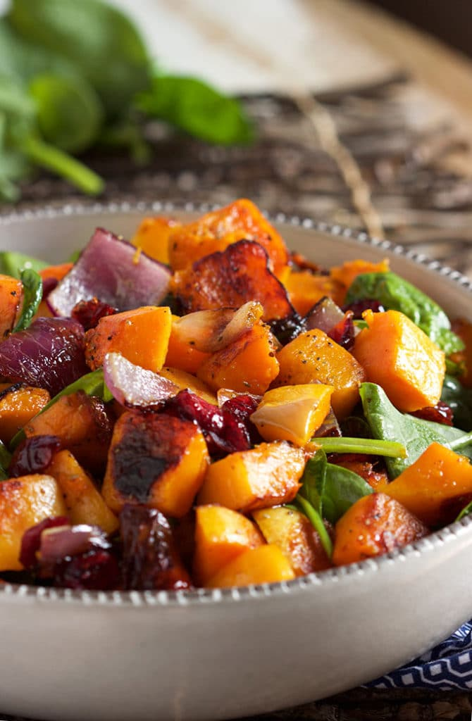 This easy Roasted Butternut Squash with Spinach and Cranberries is the most amazing vegetarian side dish ever. TheSuburbanSoapbox.com