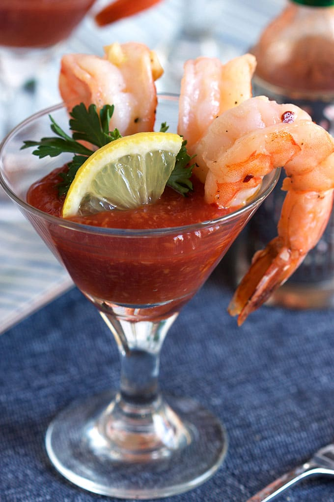This easy appetizer is ready in just 20 minutes. Garlic Roasted Shrimp Cocktail recipe is perfect for any occasion. | TheSuburbanSoapbox.com