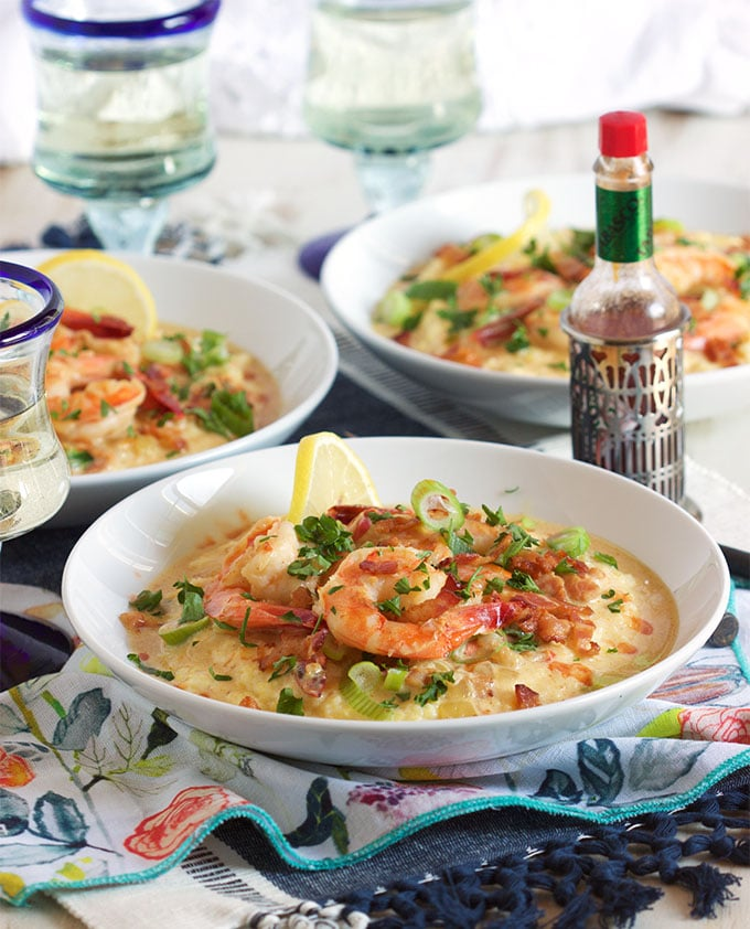 Super easy and ready in minutes, this Cheesy Shrimp and Grits recipe is the BEST ever!   TheSuburbanSoapbox.com