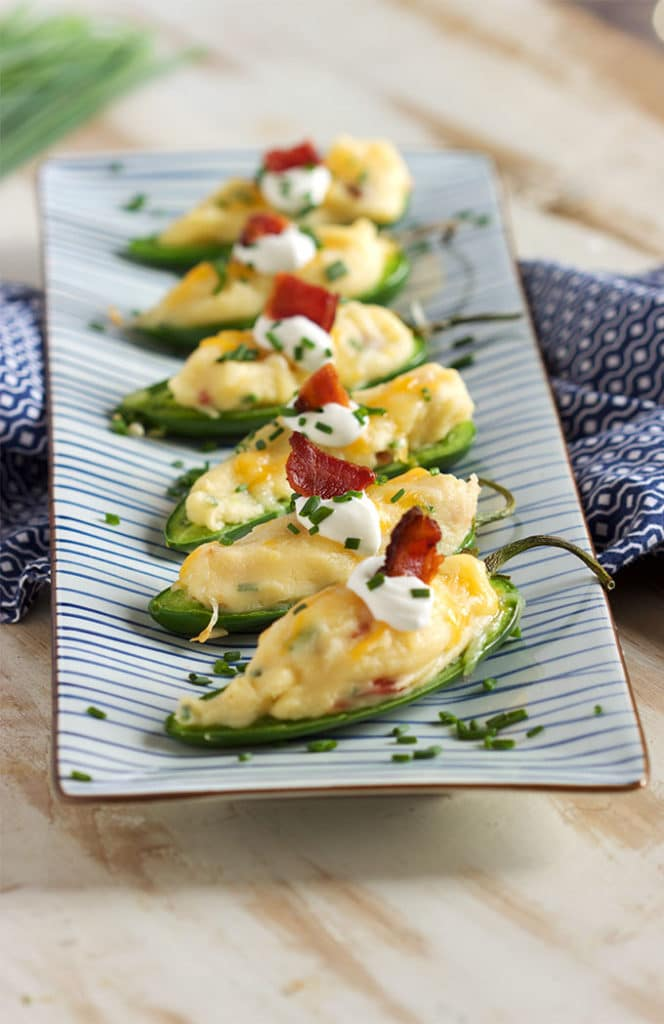 A tasty twist on a classic, Loaded Baked Potato Jalapeño Poppers are the perfect tailgating snack. Easy and quick! | TheSuburbanSoapbox.com
