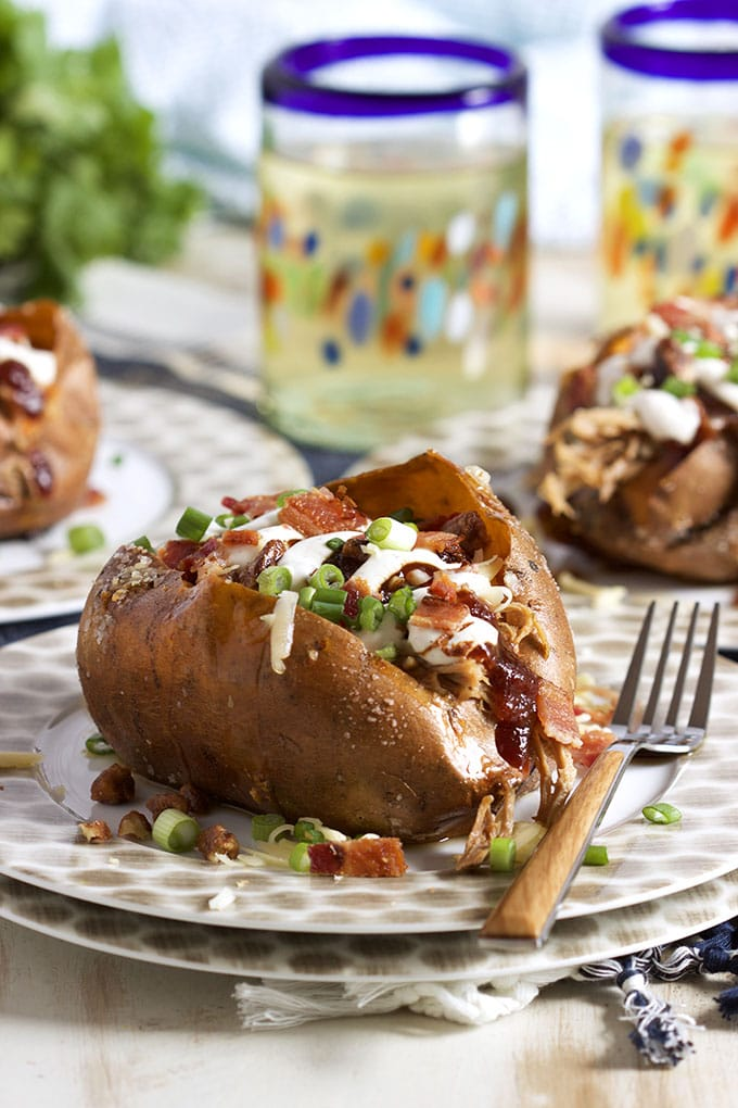 Super easy to make Loaded Pulled Pork Stuffed Sweet Potatoes are a quick easy weeknight dinner solution! | TheSuburbanSoapbox.com