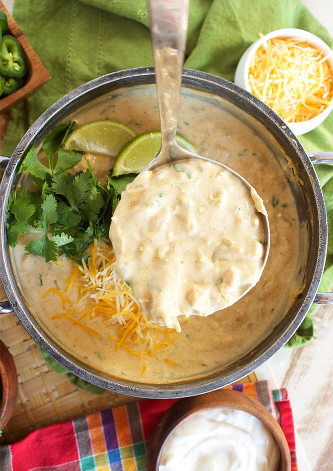 Ready in just 30 minutes with slow simmered flavor, this is the BEST Creamy White Chicken Chili Recipe ever. | TheSuburbanSoapbox.com
