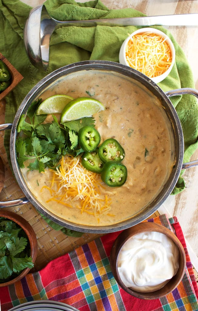 Ready in just 30 minutes with slow simmered flavor, this is the BEST Creamy White Chicken Chili Recipe ever.   TheSuburbanSoapbox.com