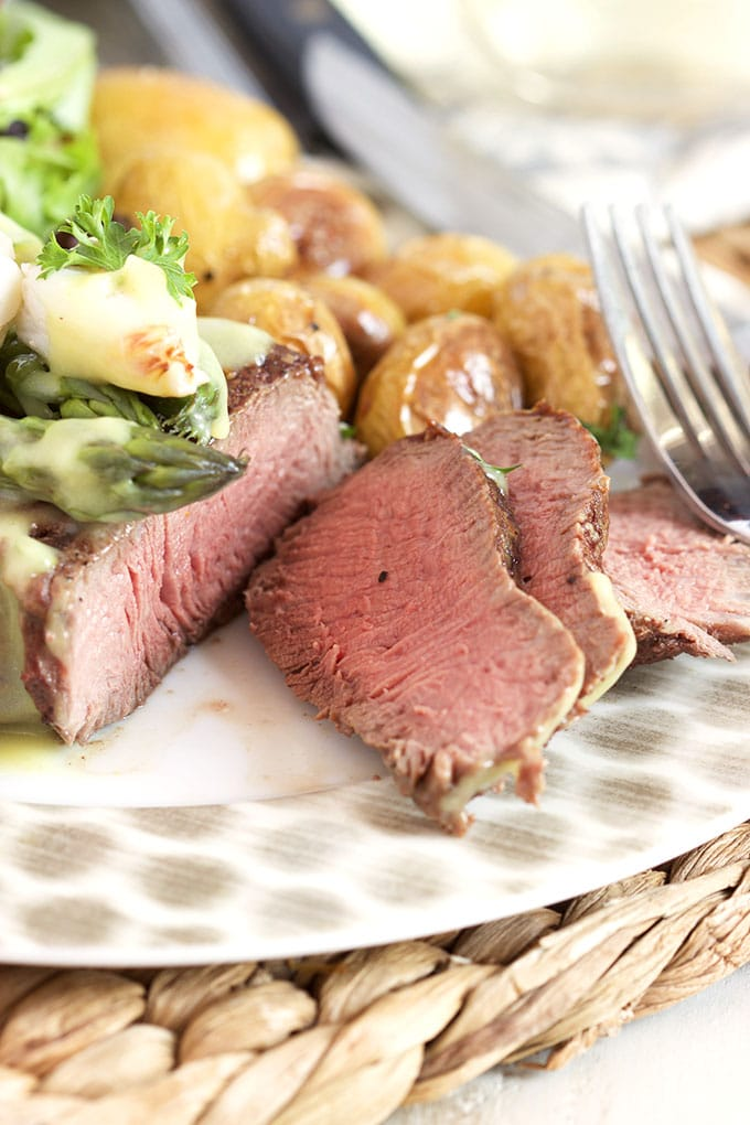 An easy and impressive dinner that's ready in less than 30 minutes! Pan Roasted Filet Mignon Oscar Style recipe is a fantastic special occasion dinner. | TheSuburbanSoapbox.com