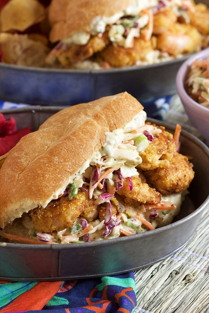 Simple to make Cornmeal Crusted Shrimp Po'Boy Sandwiches are packed with flavor and ready in minutes.   TheSuburbanSoapbox.com