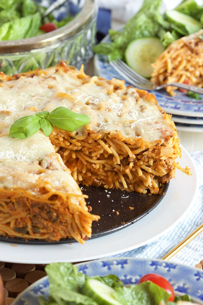 A fantastic way to use up leftover pasta and sauce, this Easy Spaghetti Pie recipe is a family favorite dinner! | TheSuburbanSoapbox.com