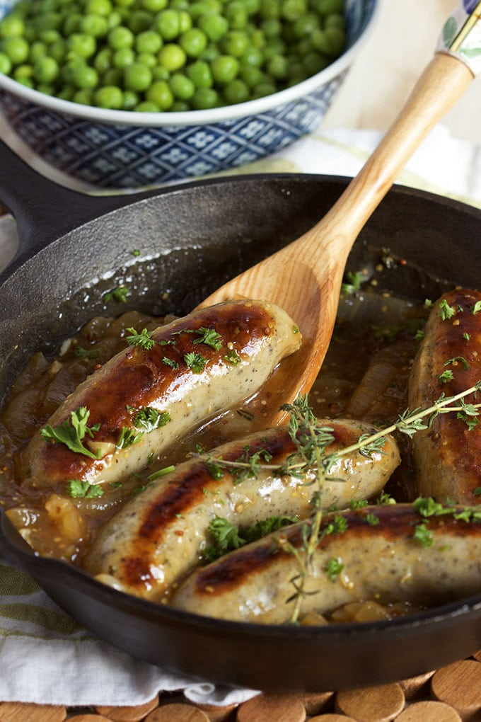 Super easy to make, Bangers and Mash with Onion Mustard Gravy is the best comfort food recipe around. Ready in less than 30 minutes. | TheSuburbanSoapbox.com