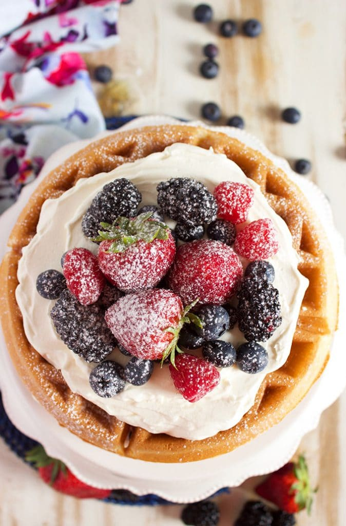 Incredibly easy to make, this Berry Vanilla Bean Belgian Waffle Cake using a simple waffle mix so your cake is ready in less than 30 minutes! | TheSuburbanSoapbox.com