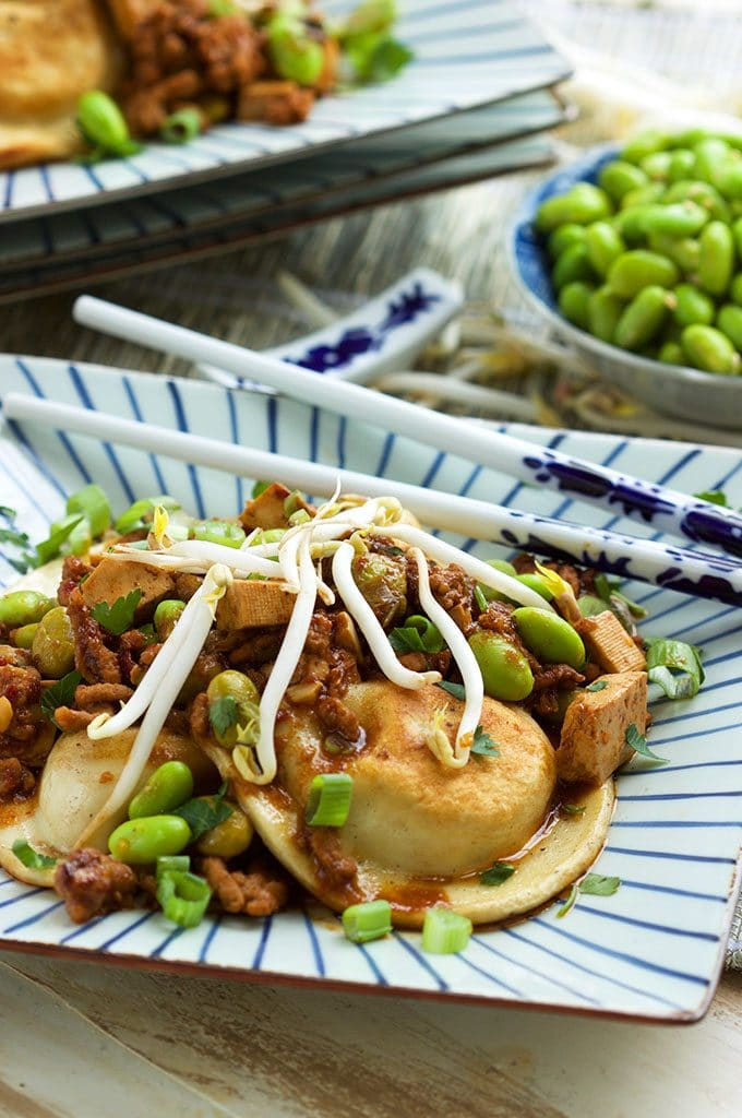 Ready in less than 30 minutes, these Easy Szechuan Style Pierogies are a great weeknight dinner you're entire family will love!   TheSuburbanSoapbox.com