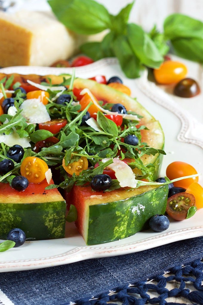 Easy and refreshing Grilled Watermelon Pizza with Blueberries, Parmesan and Arugula is a fun and tasty way to celebrate summer! | TheSuburbanSoapbox.com