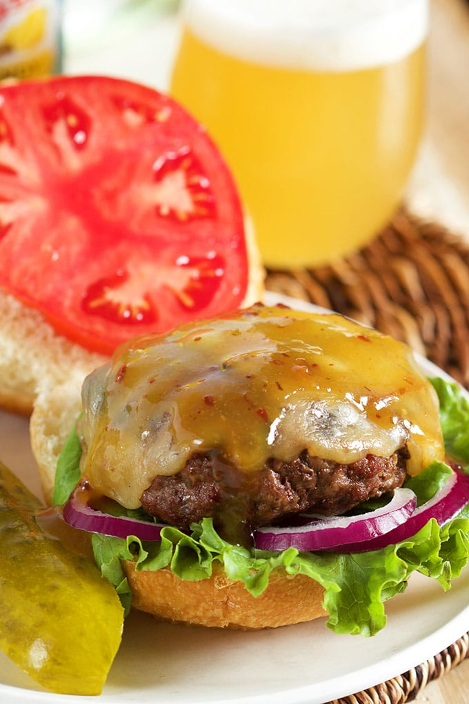 Quick and easy, the perfect tailgating burger...Maple Bourbon Burger with Bacon Mustard Sauce. | TheSuburbanSoapbox.com