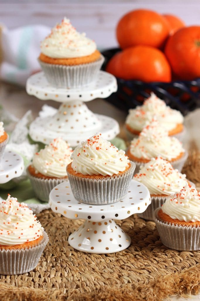 Tender and moist, this Orange Creamsicle Cupcake Recipe is like a bite of summer sunshine! Just like your favorite childhood popsicle! | TheSuburbanSoapbox.com