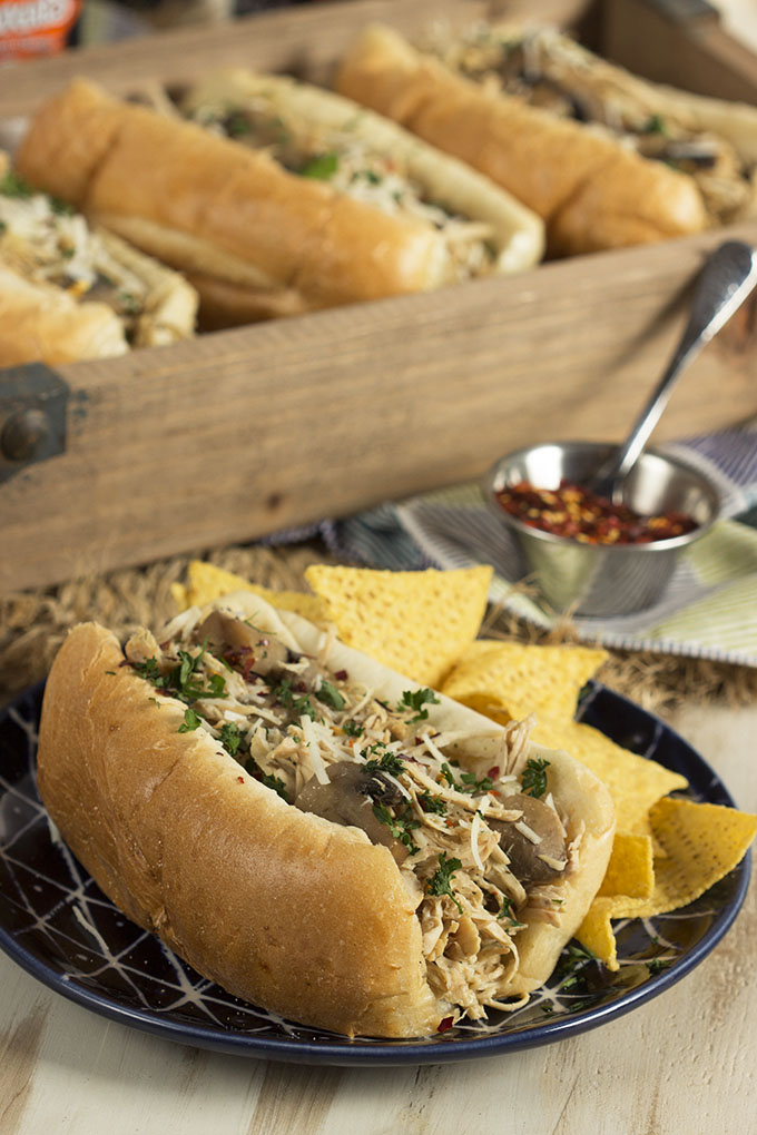Quick, easy and healthy, this simple to make Chicken philly Cheesesteak Sandwich comes together in your slow cooker or crock pot! Great for parties, football tailgating or easy weeknight dinners. | TheSuburbanSoapbox.com