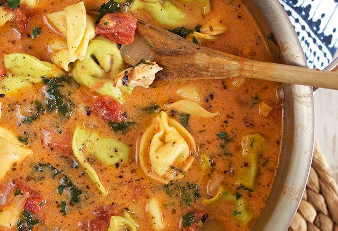 Ready in just 30 minutes, this Creamy Tuscan Chicken Tortellini Soup recipe is a family favorite. Made from scratch with pantry staples, this is the perfect soup for any week night dinner. TheSuburbanSoapbox.com @suburbansoapbox
