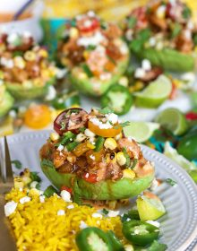 Chicken Fajita Stuffed Avocados on a white plate with Mexican saffron rice from TheSuburbanSoapbox.com