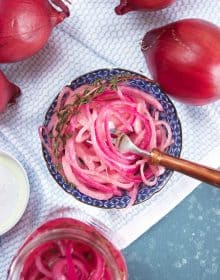 Blue and white dish with pickled red onions and a copper fork from TheSuburbanSoapbox.com