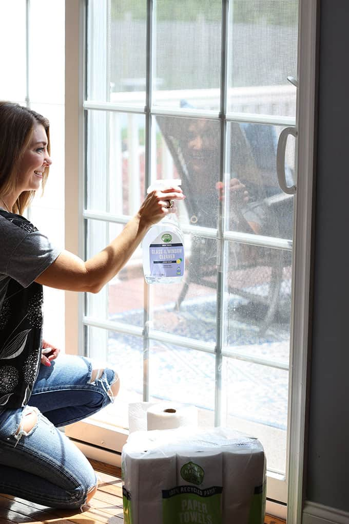 Cleaning the sliding glass door with Open Nature Window Cleaner