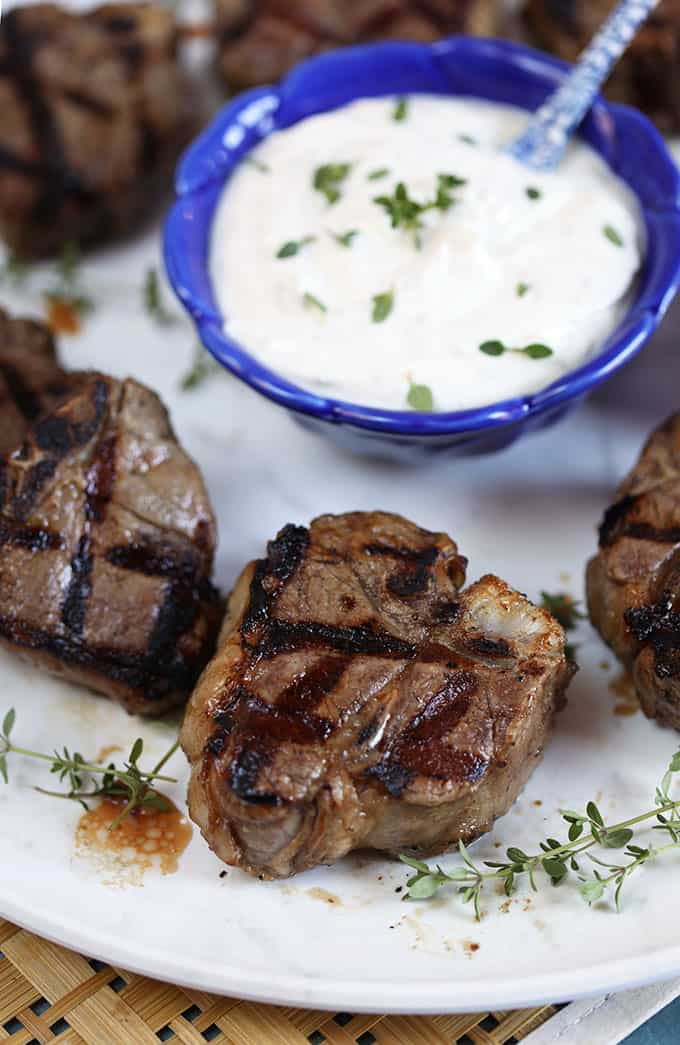 Grilled lamb chops with a bowl of goat cheese sauce from TheSuburbanSoapbox.com