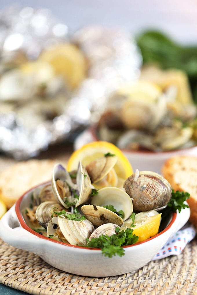 Grilled Clams with basil and lemons in a white ramekin from Thesuburbansoapbox.com