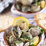 Grilled clams with lemon wedges in a white ramekin. From TheSuburbanSoapbox.com