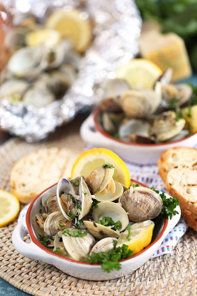Grilled clams with grilled bread and lemons.