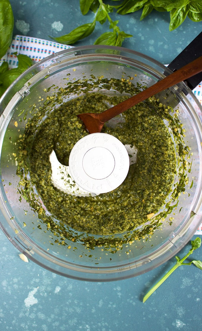 Basil Pesto in the bowl of a food processor from TheSuburbanSoapbox.com