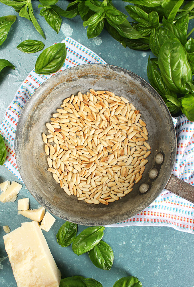 Toasted Pine Nuts in a skillet for the Very Best Basil Pesto recipe from TheSuburbanSoapbox.com