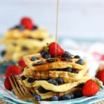 Stack of waffles with maple syrup being drizzled from TheSuburbanSoapbox.com