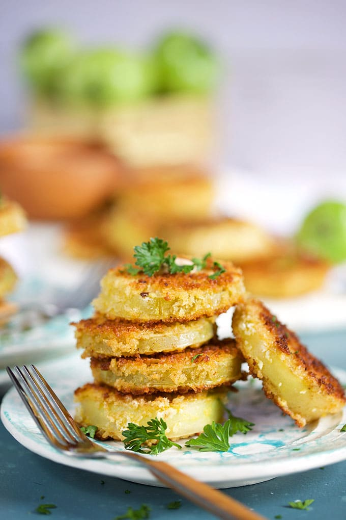 Stack of fried green tomatoes with a wooden fork from TheSuburbanSoapbox.com