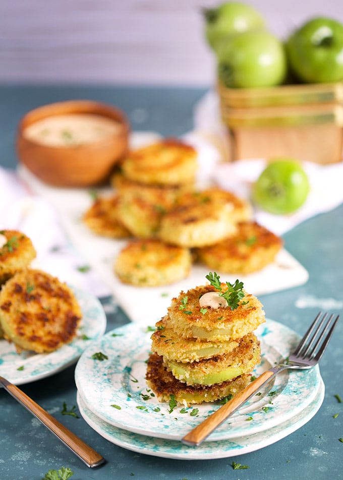 Fried Green Tomatoes on a speckled plate with remoulade sauce on a blue background from TheSuburbanSoapbox.com