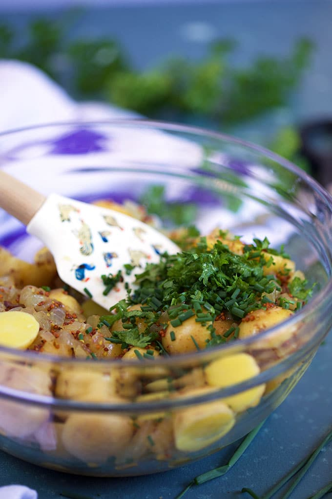 German Potato Salad in a glass bowl with parsley