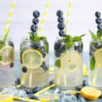 Lemonade Gin Mojito with blueberries in a glass.