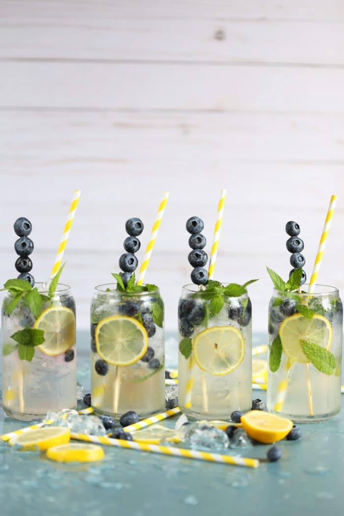 Four Lemonade Gin Mojito Cocktail recipes on a blue background from TheSuburbanSoapbox.com