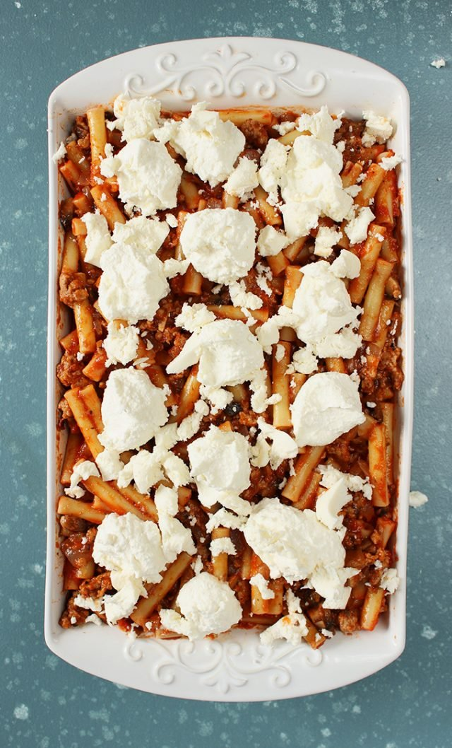Final layer of mozzarella on top of layered ziti recipe from thesuburbansoapbox.com