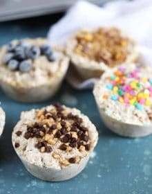 Freezer Steel Cut Oatmeal in muffin cups with toppings like blueberries, sprinkles and chocolate from TheSuburbanSoapbox.com