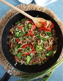 Overhead shot of beef stir fry recipe in a black wok.