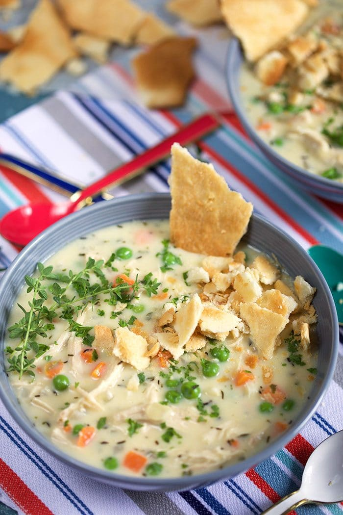 Blue bowl with chicken pot pie soup that was made in the crock pot or slow cooker.