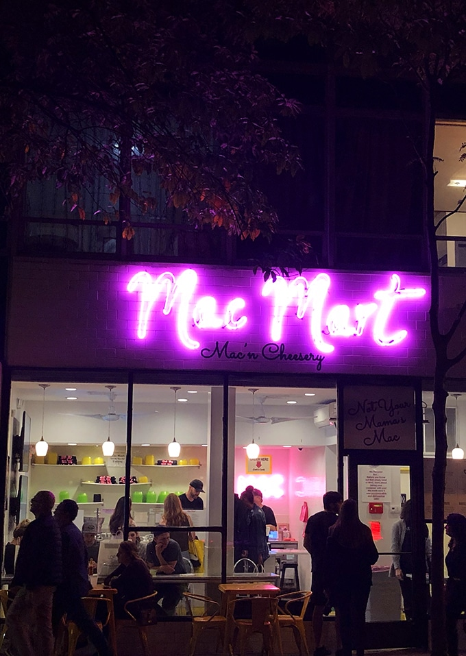 Mac Mart in Philadelphia sign at night in purple neon.
