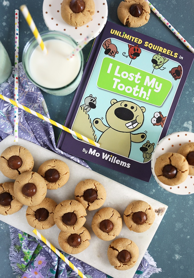 Overhead shot of peanut butter blossoms with Childs book Unlimited Squirrels I lost my tooth.