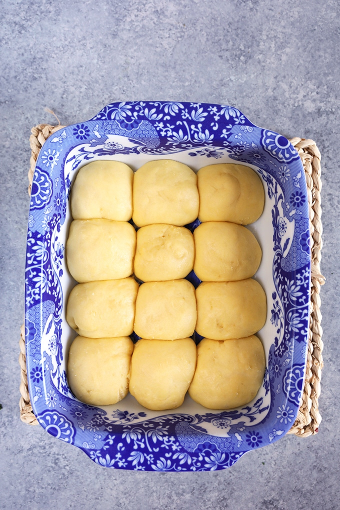 Dinner rolls in a baking dish before baking.