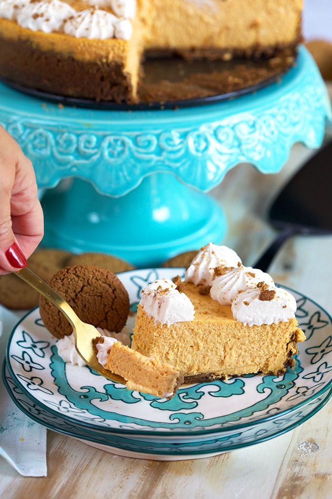 Pumpkin Cheesecake with a bite on a golden fork.