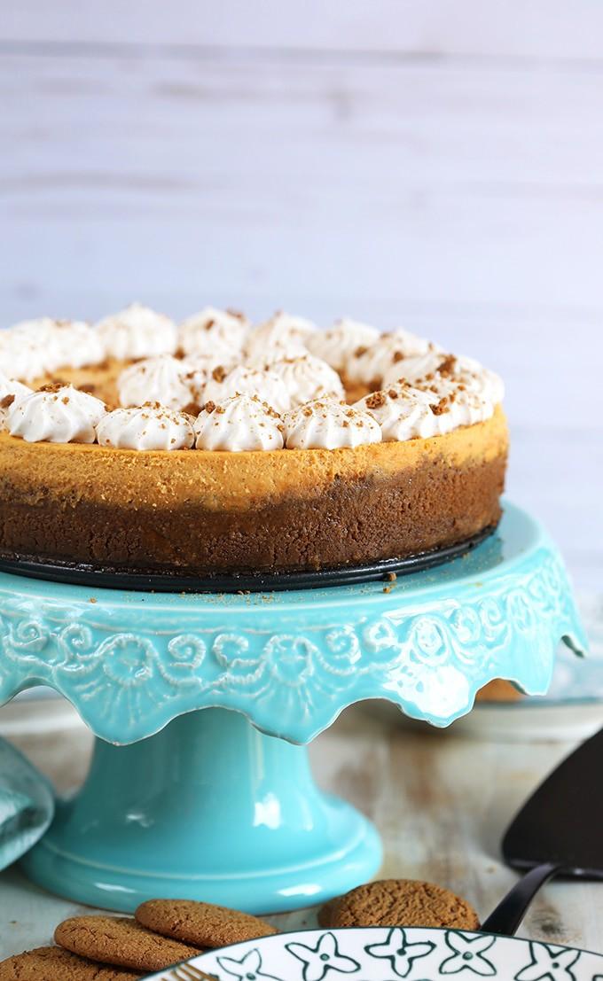 Pumpkin Cheesecake with gingersnap crust on an aqua cake plate.