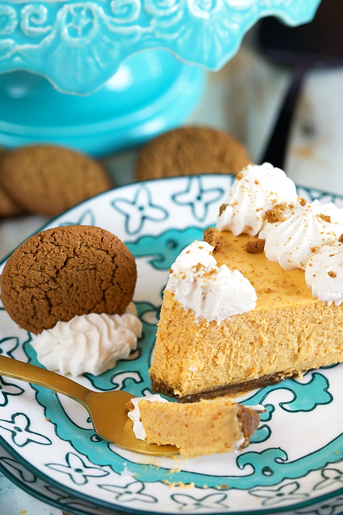 Slice of Pumpkin Cheesecake with a bite on a fork.
