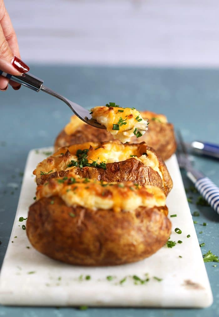 Easy Twice Baked Potatoes with a fork taking a bite.